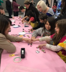 adults and kids doing electronics